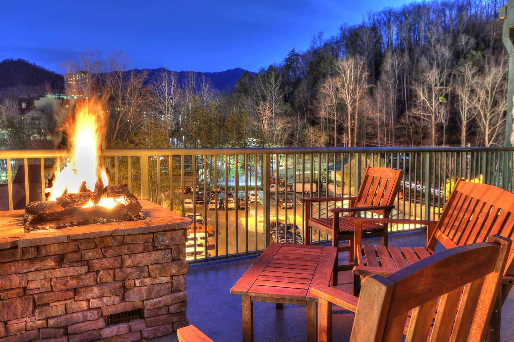 chairs surround fire pit on hotel balcony