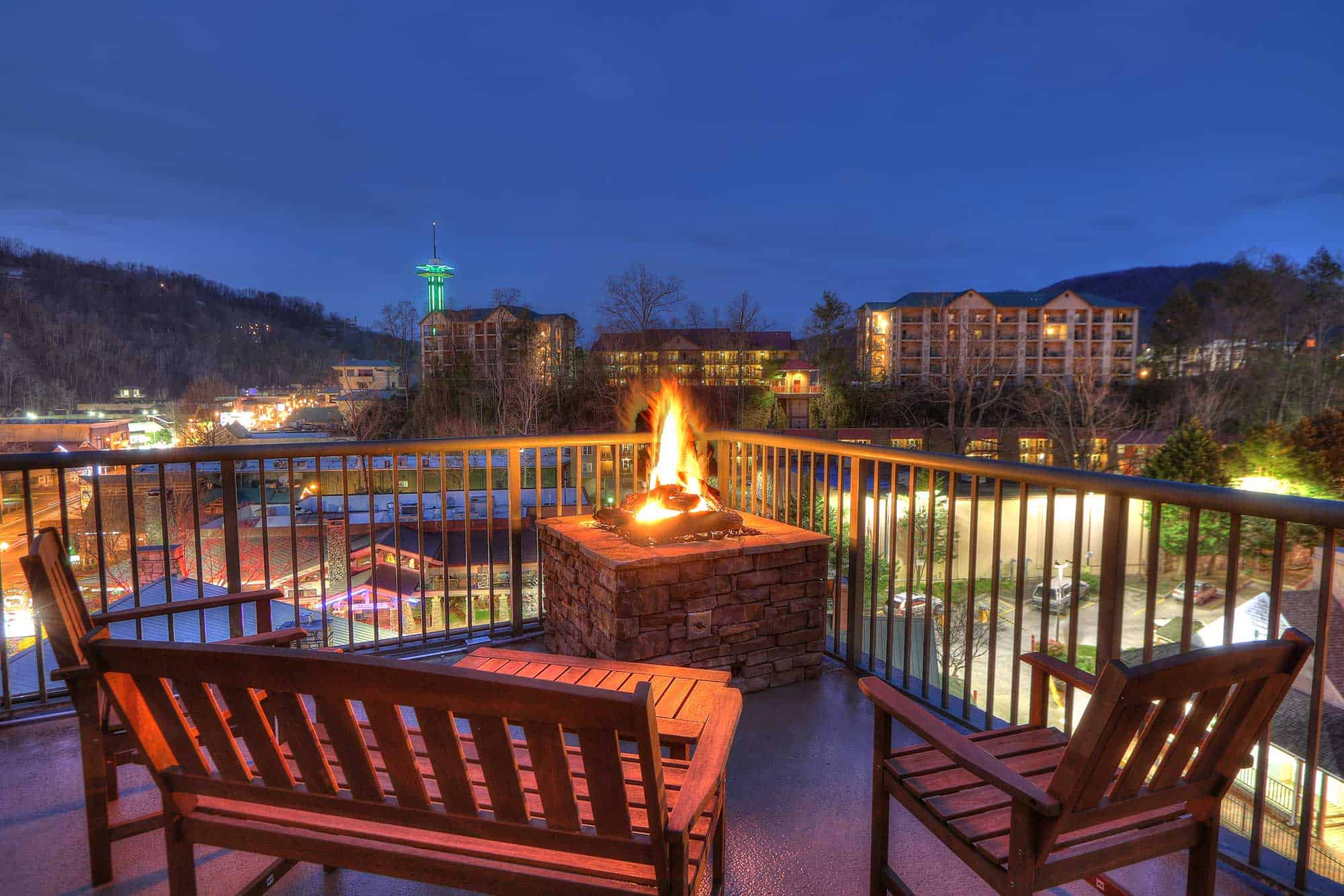 Evening view of Gatlinburg from balcony with fire pit