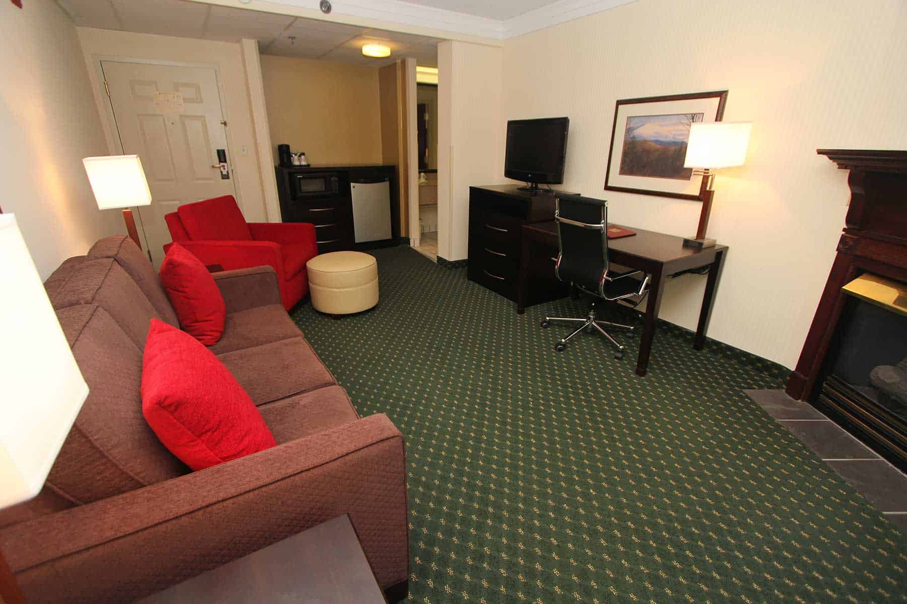 king suite with sitting room at Black Bear Inn & Suites