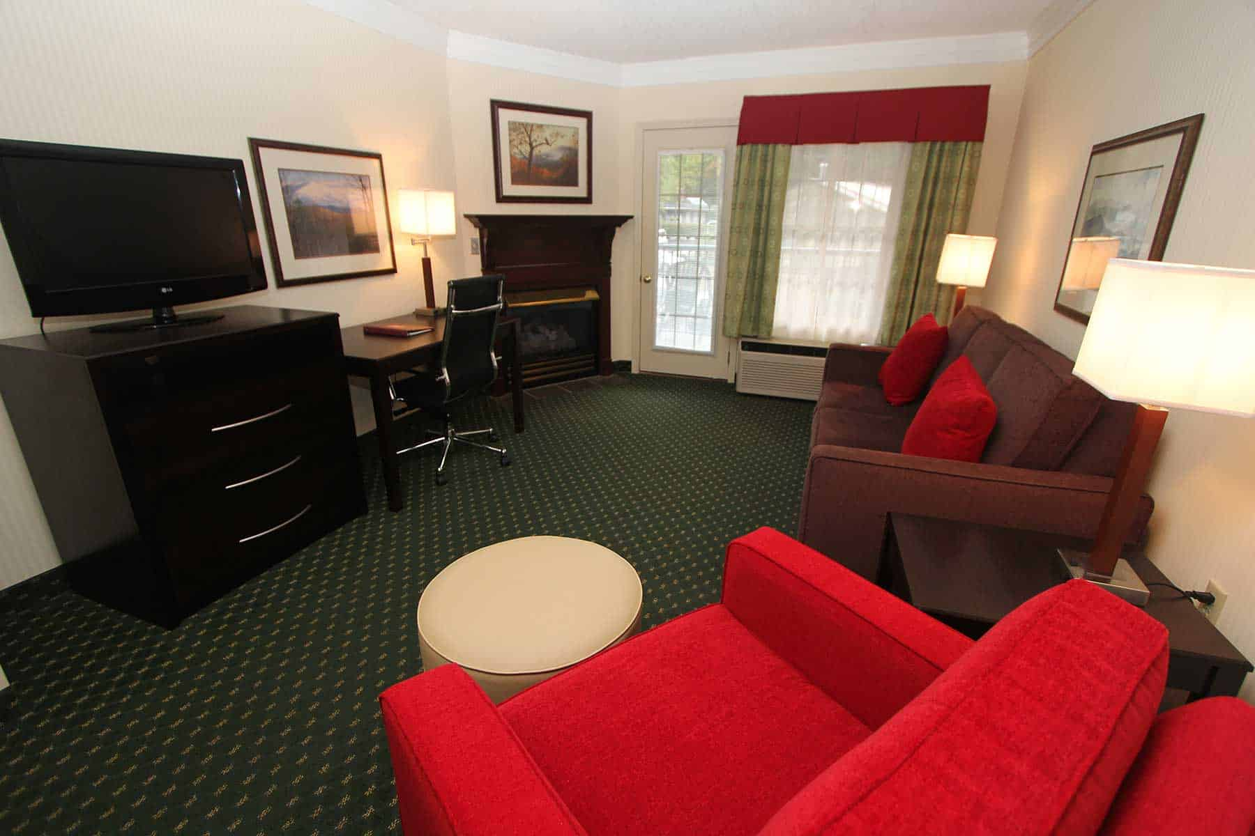sitting room with sofa, chair and fireplace in king suite at Black Bear Inn & Suites in Gatlinburg TN