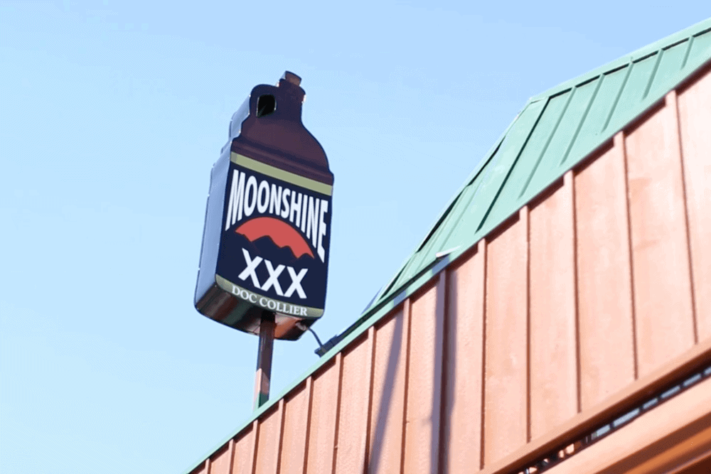 The sign for the Doc Collier Moonshine distillery in Gatlinburg TN.